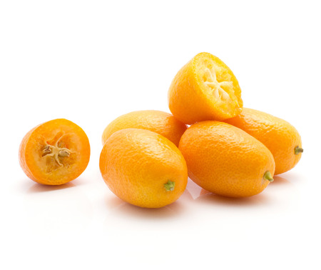 Kumquat set isolated on white background four whole and two halves ripe fresh  Imagens