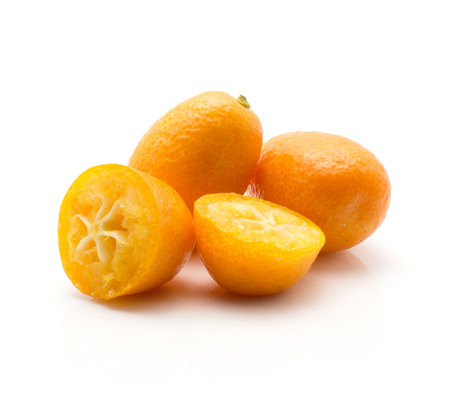 Two kumquat and two halves isolated on white background