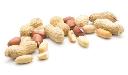 Raw peanuts heap isolated on white background (unshelled, shelled, husk, halves)