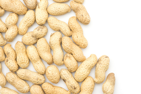Unshelled peanuts top view isolated on white background left side  Stock Photo