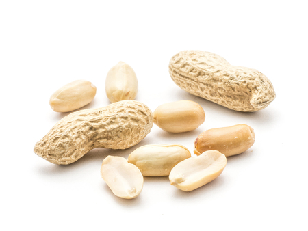 Two unshelled peanuts with raw nuts without husk and halves isolated on white background