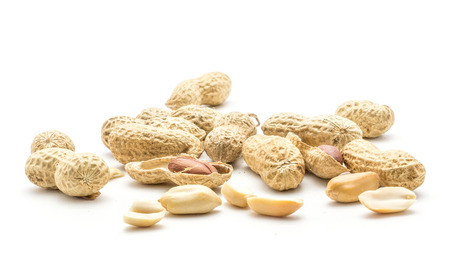 Peanut heap (shelled, unshelled, broken, halved, whole) isolated on white background