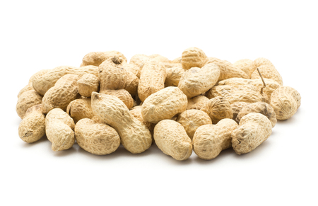 Unshelled raw peanuts heap isolated on white background  Stock Photo