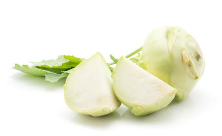 Kohlrabi (German turnip or turnip cabbage) with fresh leaves isolated on white background one bulb two slices  Stock Photo
