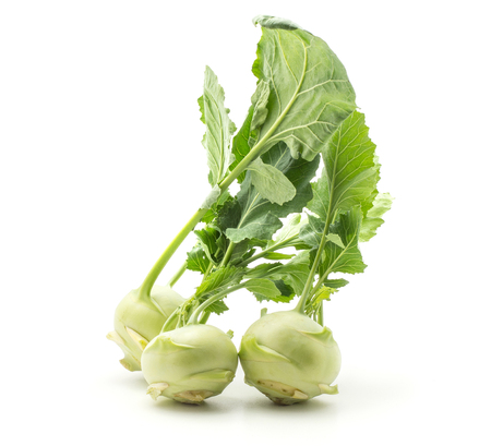Kohlrabi (German turnip or turnip cabbage) three bulbs with fresh long leaves isolated on white background raw