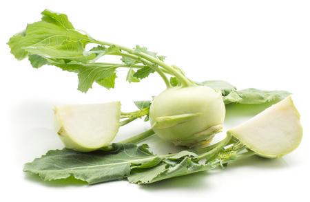 Kohlrabi (German turnip or turnip cabbage) one bulb two sliced quarters with fresh leaves isolated on white background  Zdjęcie Seryjne