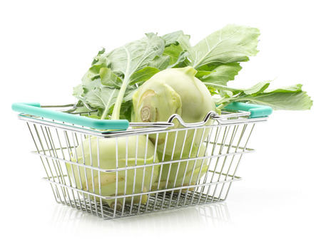 Kohlrabi (German turnip or turnip cabbage) with leaves in a shopping basket isolated on white background three raw bulbs  Stock Photo
