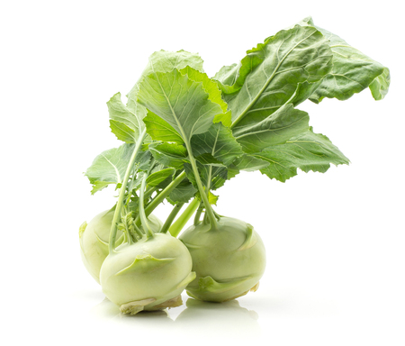 Kohlrabi (German turnip or turnip cabbage) three raw bulbs with fresh leaves isolated on white background