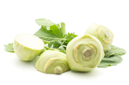 Kohlrabi (German turnip or turnip cabbage) with fresh leaves isolated on white background two bulbs and two sliced halves