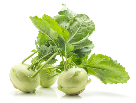 Kohlrabi (German turnip or turnip cabbage) isolated on white background three raw bulbs with fresh leaves