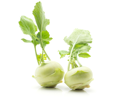 Kohlrabi (German turnip or turnip cabbage) with fresh leaves isolated on white background two raw bulbs