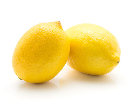 Yellow lemons isolated on white background two whole ripe