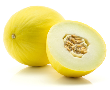 Yellow honeydew melon and one half with seeds isolated on white background