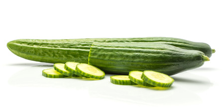 Two European cucumbers (burpless, seedless, hothouse, gourmet, greenhouse, English) and fresh cut slices isolated on white background