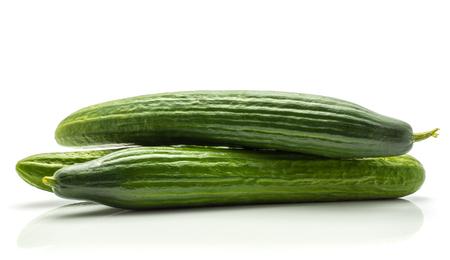 Three European cucumbers (burpless, seedless, hothouse, gourmet, greenhouse or English) isolated on white background Standard-Bild
