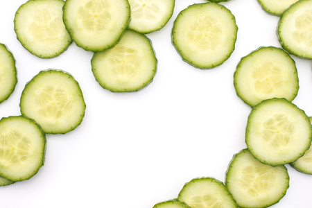 European cucumber slices background (burpless, seedless, hothouse, gourmet, greenhouse, English) isolated on white top view  Stock Photo