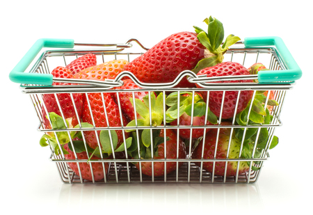 Fresh strawberries in a shopping basket isolated on white background