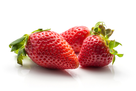 Three garden strawberries isolated on white background ripe and fresh