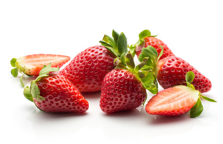 Garden strawberries set isolated on white background ripe whole and one cut in half