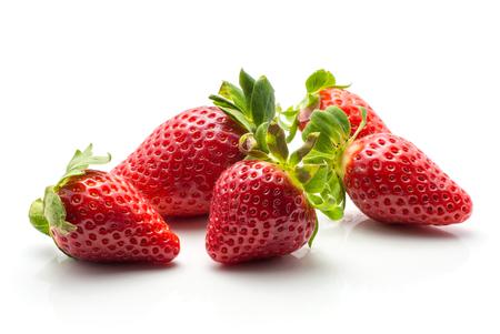 Five garden strawberries isolated on white background ripe fresh