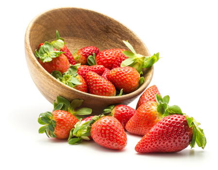 Garden strawberries out a wooden bowl isolated on white background  Stock Photo