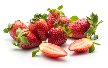 Garden strawberries stack isolated on white background ripe whole and one cut in half