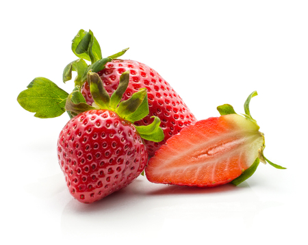Two garden strawberries one fresh cut half isolated on white background  Stock Photo