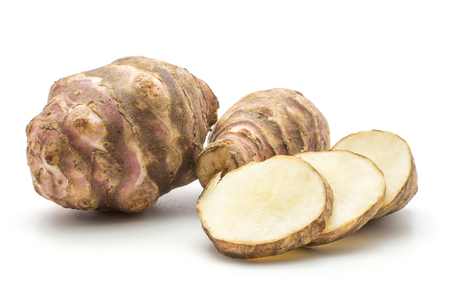 Two Jerusalem artichoke tubers with three round slices isolated on white background sweet crisp topinambur set