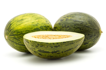Two melons Piel de Sapo with cross section half (Santa Claus Christmas variety) isolated on white background green striped outer rind