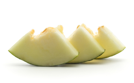 Melon Piel de Sapo three cut pieces (Santa Claus Christmas variety) isolated on white background without seeds in row