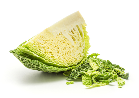 One savoy cabbage slice with chopped leaves stack isolated on white background fresh green