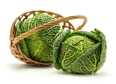 Savoy cabbages in a wicker basket isolated on white background two fresh green heads