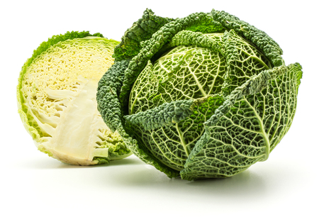 Savoy cabbage head and one half isolated on white background fresh green  Stock Photo