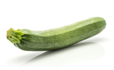 Green zucchini isolated on white background one long raw courgette