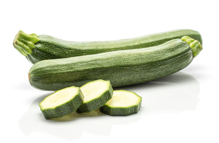 Two green zucchini and three round slices isolated on white background long raw courgette  Stock Photo