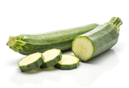 One green zucchini one half three round slices isolated on white background long raw courgette