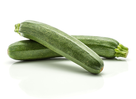 Green zucchini isolated on white background two raw courgette