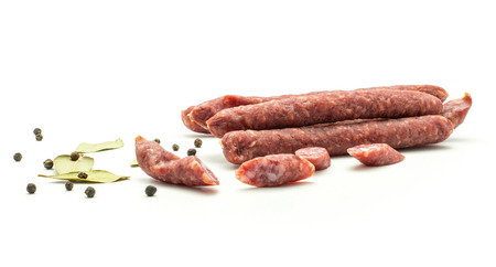 Hungarian dry sausages pepperoni composition isolated on white background smoked in natural casing mixed pork and beef with black pepper and bay leaves