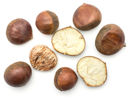 European chestnuts Spanish edible whole halved and peel isolated on white background raw fresh brown nuts top view