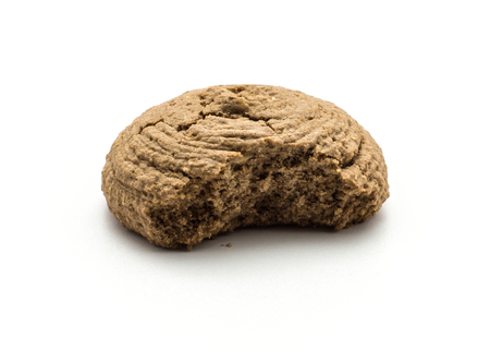 One bitten cocoa oat cookie isolated on white background drop shape brown crispy biscuit