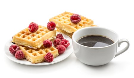 Traditional waffle (Belgian) with honey and fresh raspberries on a saucer with a cup of black coffee isolated on white background sweet delicate and airy delicious breakfast  Stock Photo