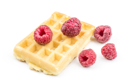 Traditional waffle (Belgian) with fresh red raspberries isolated on white background one sweet delicate and airy  Stock Photo