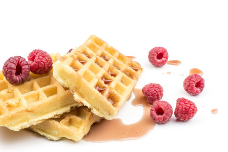 Traditional waffle (Belgian) with fresh red raspberries and syrup isolated on white background three sweet delicate and airy  Stock Photo