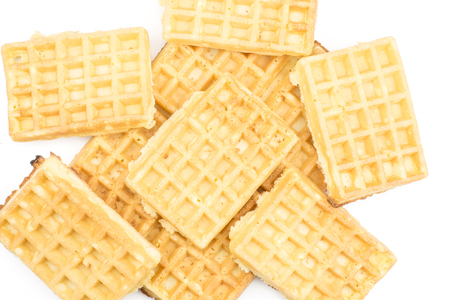Traditional waffle (Belgian) stack top view isolated on white background sweet delicate and airy  Stock Photo