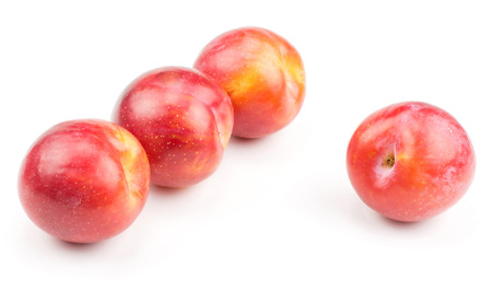 Four plums red orange isolated on white background fresh and glossy
