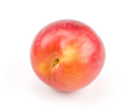 One plum red orange isolated on white background fresh and glossy  Stock Photo