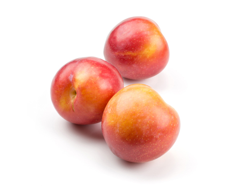 Three plums red orange isolated on white background