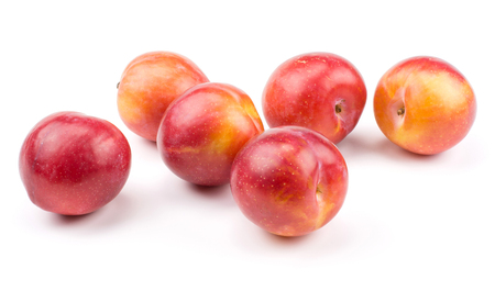 Six plums red orange stack isolated on white background