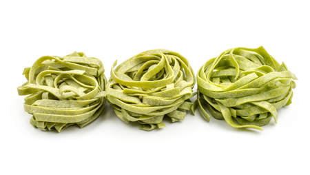 Spinach fettuccine pasta three raw isolated on white background  Stock Photo