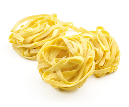 Fettuccine pasta classic three pieces raw isolated on white background